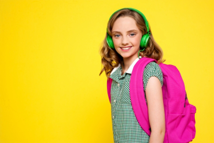 Smiling Girl Posing With Headphones/freedigitalphotos.net