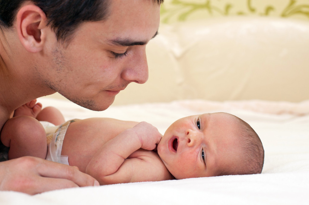 Father-looking-at-newborn-shutterstock_74803552